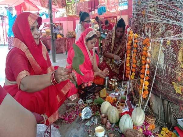 Women take holy dip in River Ganga, offer prayers to banyan tree on 'Vat Savitri Puja' in Prayagraj