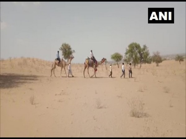 Teachers traveling by camel to teach students lacking mobile networks in rural Rajasthan