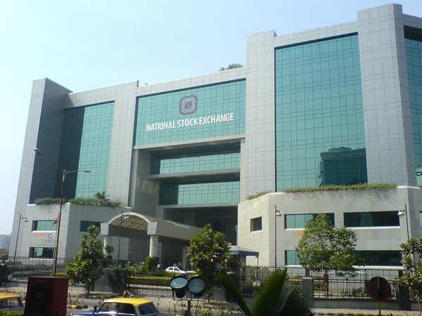 Equity gauges subdued, Tata Motors down 2 pc